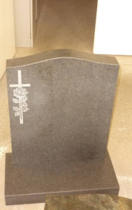 honed granite headstone with carving